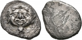 ETRURIA. Populonia. Circa 425-400 BC. 10 Asses (Silver, 22 mm, 7.28 g). Diademed facing head of Metus with protruding tongue; below, X (mark of value)...