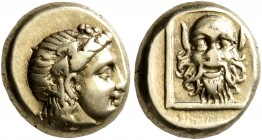 LESBOS. Mytilene. Circa 377-326 BC. Hekte (Electrum, 11 mm, 2.59 g, 12 h). Head of Dionysos to right, wearing wreath of ivy and fruit. Rev. Bald facin...