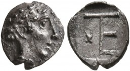 IONIA. Kolophon. Circa 450-410 BC. Tetartemorion (Silver, 7 mm, 0.31 g, 12 h), Persic standard. Laureate head of Apollo to right. Rev. Monogram of TE;...