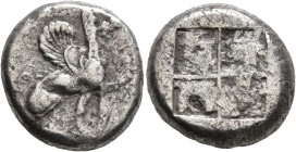 IONIA. Teos. Circa 465-440 BC. Stater (Silver, 20 mm, 11.58 g). Griffin seated right, raising right forepaw; below, T. Rev. Quadripartite incuse squar...