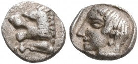 CARIA. Knidos. Circa 490-465 BC. Tetartemorion (Silver, 6 mm, 0.24 g, 4 h). Forepart of a roaring lion to left. Rev. Bare head of a male to left withi...