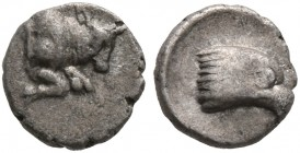 CARIA. Uncertain. 5th century BC. Tetartemorion (Silver, 5 mm, 0.16 g, 6 h). Forepart of a bull to right. Rev. Head of an eagle to right within shallo...