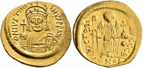 Justinian I, 527-565. Solidus (Gold, 21 mm, 4.50 g, 6 h), Constantinopolis, circa 538-545. D N IVSTINIANVS P P AVG Helmeted and cuirassed bust of Just...