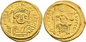 Justin II, 565-578. Solidus (Gold, 20 mm, 4.48 g, 6 h), Constantinopolis, 566/7-578. D N IVSTINVS P P AVI Helmeted and cuirassed bust of Justin II fac...