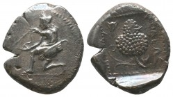 CILICIA, Soloi. 425-400. Stater, Amazon, nude to the waist and seen from behind, kneeling to left and stringing her bow; wearing bonnet and with her g...