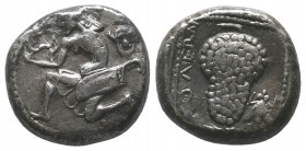 CILICIA, Soloi. 425-400. Stater . Amazon, nude to the waist and seen from behind, kneeling to left and stringing her bow; wearing bonnet and with her ...