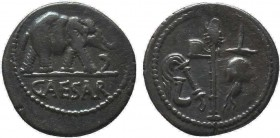 Julius Caesar. 49-48 B.C. AR denarius. Mobile military mint traveling with Caesar. CAESAR in exergue, elephant advancing right, trampling on horned se...