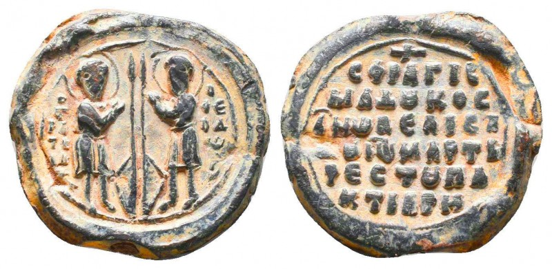 Lead seal of Ioannes Paktiares (ca 11th cent.). Obverse: Saints Theodoros Tiron ...