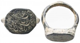 Very Large Bronze Islamic ring with an inscription on bezel, Circa 13th-16th Century AD.  Condition: Very Fine  Weight: 8.40 gr Diameter: 25 mm