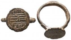 Bronze Islamic ring with an inscription on bezel, Circa 10th-13th Century AD.  Condition: Very Fine  Weight: 5.80 gr Diameter: 25 mm