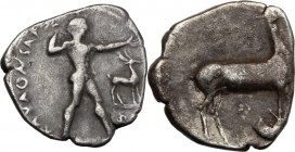 Greek Italy. Bruttium, Kaulonia. AR Stater, c. 420-410 BC. D/ KAVΛΩNIATAΣ. Apollo advancing right; stag in right field; below, uncertain symbol. R/ St...