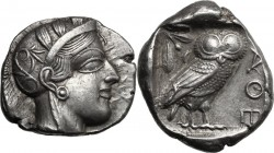 Continental Greece. Attica, Athens. AR Tetradrachm, c. 454-404 BC. D/ Helmeted head of Athena right, with frontal eye. R/ AΘE. Owl standing right, hea...