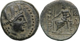 Greek Asia. Cilicia, Tarsos. AE 20 mm, 164 BC and later. D/ Turreted head of Tyche right. R/ Zeus seated left; two monograms to right. Cf. SNG Levante...