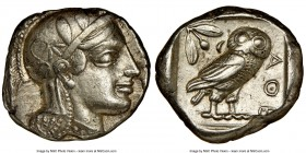 ATTICA. Athens. Ca. 455-440 BC. AR tetradrachm (24mm, 17.17 gm, 7h). NGC XF 5/5 - 4/5. Early transitional issue. Head of Athena right, wearing crested...
