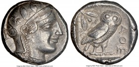 ATTICA. Athens. Ca. 455-440 BC. AR tetradrachm (25mm, 17.14 gm, 10h). NGC Choice XF 5/5 - 4/5. Early transitional issue. Head of Athena right, wearing...