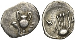 Northern Apulia, Canusium, Obol, ca. 300-250 BC. AR (g 0,39; mm 11; h 9). Cantharus between cornucopiae and oinochoe, Rv. Lyre; on l., K; on r., A. HN...