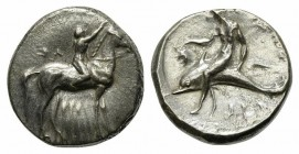 Southern Apulia, Tarentum, Nomos, ca. 302-280 BC. AR (g 7,90; mm 20; h 1). Youth on horseback r., crowning horse with wreath; [ΣA to l.], ΦIΛI/APXOΣ i...