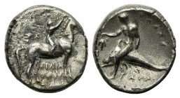 Southern Apulia, Tarentum, Nomos, ca. 302-280 BC. AR (g 7,64; mm 20; h 6). Youth on horseback r., crowning horse with wreath; ΣA to l., ΦIΛI/APXOΣ in ...