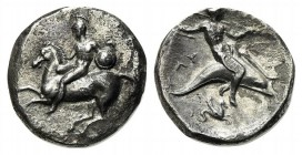 Southern Apulia, Tarentum, Nomos, ca. 280 BC. AR (g 7,36; mm 20; h 6). Warrior, holding shield and rein, on horseback l.; Rv. Phalanthos, holding trid...