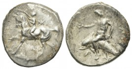 Southern Apulia, Tarentum, Nomos, ca. 280-272 BC. AR (g 5,83; mm 21; h 3). Nude youth on horse stepping l., crowning it with wreath; NK monogram to r....