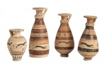 Collection of Four Etrusco-Corinthian Aryballoi, 7th century BC; height max cm 11,5; Very fine collection composed by one small piriform aryballos of ...
