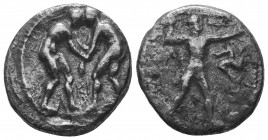 Aspendos, Pamphylia. AR Stater c. 380-325 BC. Obv. Two wrestlers; between them, AΦ. Rev. EΣTFEΔIIY, slinger to right, triskeles in right field. SNG vo...
