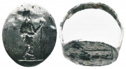 Roman, c. 1st-4th century AD. Beautiful Silver Seal Ring, with a standing figure on Bezel, Condition: Very Fine  Weight: 3.70 gr Diameter: 19 mm