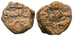 Early islamic lead seal with inscriptions in either side in cufic Arabic. Interesting!
