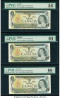 Canada Bank of Canada $1 1973 BC-46aA Three Consecutive Replacement Examples PMG Choice About Unc 58 EPQ; Choice Uncirculated 64 EPQ; Gem Uncirculated...
