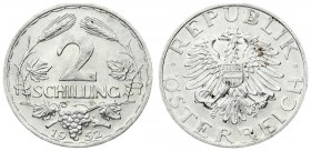 Austria 2 Schilling 1952 Averse: Imperial Eagle with Austrian shield on breast holding hammer and sickle. Reverse: Thick value above spray of leaves a...