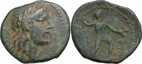 Sicily. Akragas. AE 19 mm, 240-212 BC. D/ Head of Apollo right, laureate. R/ Nude warrior striding right, attacking with spear. CNS I, 143. AE. g. 6.7...
