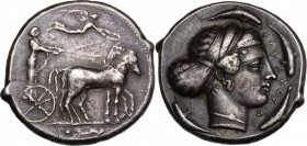 Sicily. Syracuse. Second Democracy (466-405 BC). AR Tetradrachm. D/ Charioteer driving quadriga right; above, Nike flying left, crowning charioteer. R...