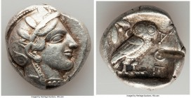 ATTICA. Athens. Ca. 455-440 BC. AR tetradrachm (25mm, 17.19 gm, 9h). VF, test cut. Early transitional issue. Head of Athena right, wearing crested Att...