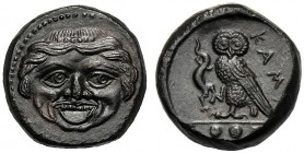 Sicily, Tetras, Kamarina, c. 420-405 BC AE (g 2,93 mm 14 h 4) Gorgoneion, dotted border, Rv. KAMA, owl standing l., holding lizard with claw in ex. th...