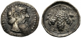 Sicily, Litra, Naxos, After 461 BC AR (g 0,85 mm 10 h 12) Head of Dionysos r., wearing ivy-wreath dotted border, Rv. NAXI (retr.), bunch of grapes. Ca...