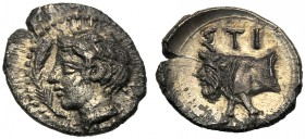 Sicily, Hemilitra, Stiela, c. 420-415 BC AR (g 0,39 mm 8 h 4) Laureate head of Apollo (?) at l. at l., branch. Dotted border, Rv. ΣTI, forepart of man...