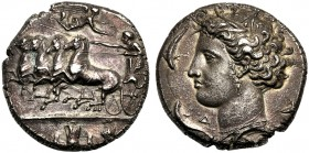 Sicily, Dionysios I (405-367), Decadrachm, Syracuse, Signed dies of Euainetos, c. 400-395 BC AR (g 43,10 mm 34 h 9) Charioteer, holding kentron and re...