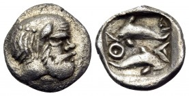ISLANDS OFF THRACE, Thasos. Circa 411-404 BC. Hemiobol (Silver, 8.5 mm, 0.40 g, 3 h). Head of bald and bearded Selinos to right. Rev. Θ-Α-Σ Two dolphi...