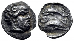 ISLANDS OFF THRACE, Thasos. Circa 412-404 BC. Hemiobol (Silver, 9 mm, 0.39 g, 12 h). Head of bald and bearded Selinos to right. Rev. Θ-Α-Σ-I Two dolph...