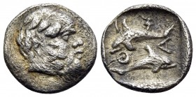 ISLANDS OFF THRACE, Thasos. Circa 412-404 BC. Hemiobol (Silver, 9 mm, 0.42 g, 5 h). Head of bald and bearded Selinos to right. Rev. Θ-Α-Σ-I Two dolphi...