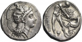Lucania, Heraclea. Nomos circa 360-320, AR 7.86 g. Head of Athena r., wearing crested helmet decorated with Scylla hurling stone; before head, EY. Rev...