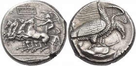 Sicily, Agrigentum. Tetradrachm circa 407, AR 17.22 g. Prancing quadriga driven l. by Nike holding kentron and reins; beneath the further horse loose ...