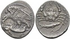Sicily, Agrigentum. Hemidrachm circa 410, AR 1.84 g. Eagle flying l., perching on hare held in its talons. Rev. A – K – [R] – A Crab seen from above; ...