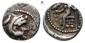 "Kings of Macedon. Tyre. Alexander III ""the Great"" 336-323 BC. Struck under Menes. Dated RY 21 of Azemilkos (329/8 BC). Obol AR"