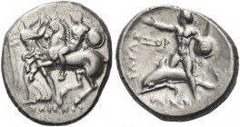 Calabria, Tarentum. Nomos circa 281-270 BC, AR 7.91 g. Helmeted horseman with shield and spear on prancing horse restrained by Nike standing l. before...