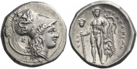 Lucania, Heraclea. Nomos circa 330-320 BC, AR 7.86 g. Head of Athena r., wearing helmet decorated with Scylla hurling stone; behind neck, K. Rev. Hera...