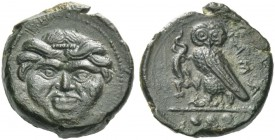 Camarina. Tetras circa 420-410, Æ 3.34 g. Gorgoneion, hair bound with fillet. Rev. Owl standing l. on one leg, clutching lizard with the other claw; i...