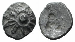 Ionia, Erythrai, c. 550-500 BC. AR Hemiobol (7mm, 0.38g). Rosette with central pellet-in-annulet. R/ Rough square punch. Unpublished in the standard r...