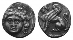 CILICIA. Uncertain, but perhaps Mallos. Circa 4th century B. Obol. Facing gorgoneion, wearing triple-pendant earrings. Rev. Sphinx seated to left. Gök...