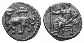 CILICIA. Tarsos. Mazaios, satrap of Cilicia, 361/0-334 BC. Obol . Baaltars seated left on backless throne, his body turned to front, holding eagle-tip...